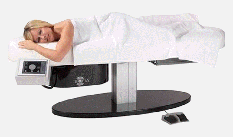 This is an image of a women comfortably lying on the SOFIA examination table in  the prone position during the 3D Automated Breast Ultrasound (ABUS) Exam of her breast.  We understand how important privacy is to some patients.  Therefore during the examination the patient can remain covered during the 3D Automated Breast Ultrasound (ABUS) exam.    SOFIA was developed based on patient input instead of attempting to apply technology to patients.    Potential patients  advised us that they were looking for a way to routinely have their breast checked for breast cancer that was: comfortable, private, natural, painless, holistic, compression-less, ion radiation-free, rapid, accurate,  efficient, eliminates callbacks, 3D, comprehensive,